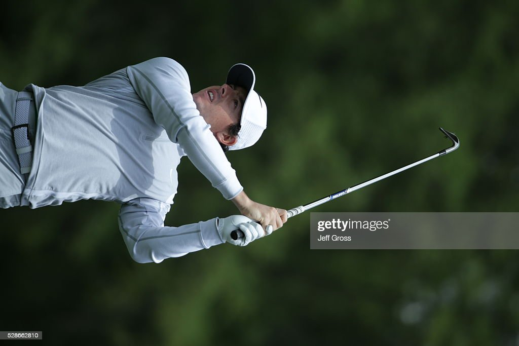 Rory McIlroy of Northern Ireland hits his approach shot on the first hole during the second round of the Wells Fargo Championship at Quail Hollow Club on May 6, 2016 in Charlotte, North Carolina.