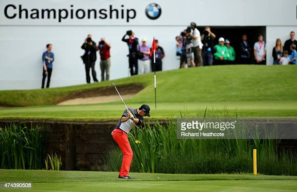 Rory McIlroy of Northern Ireland hits his approach to the 18th green during day 2 of the BMW PGA Championship at Wentworth on May 22 2015 in Virginia...