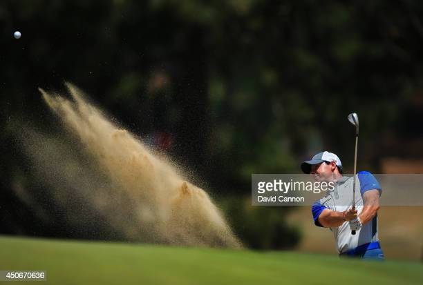 Rory McIlroy of Northern Ireland hits his second shot from a bunker on the third hole during the final round of the 114th US Open at Pinehurst Resort...