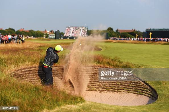 Rory McIlroy of Northern Ireland hits his second shot from a bunker on the 16th hole during the second round of The 143rd Open Championship at Royal...
