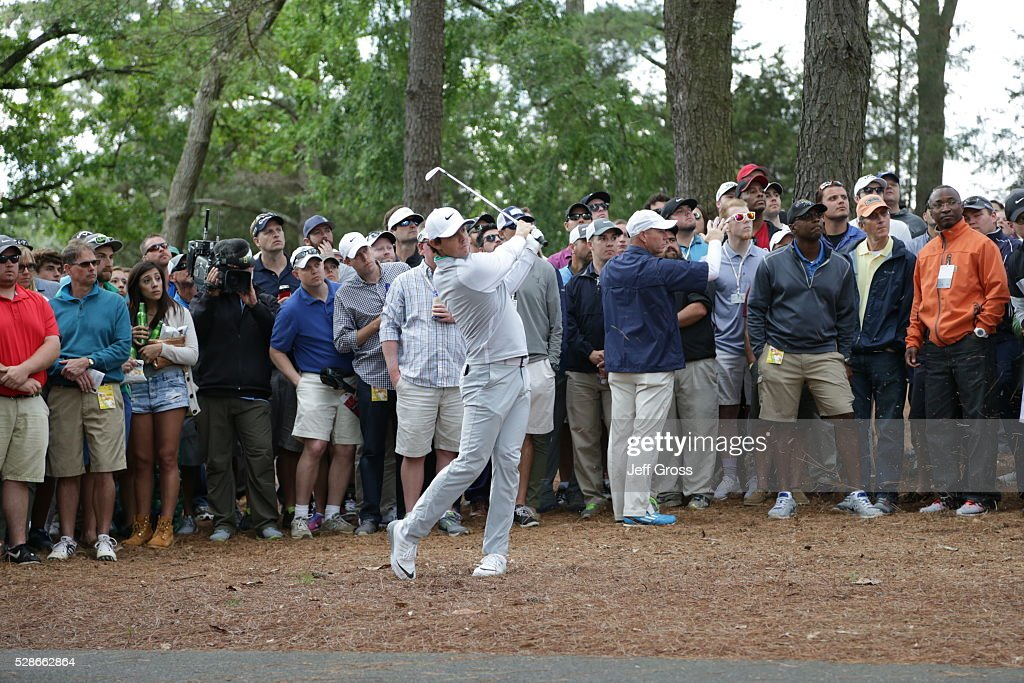 Rory McIlroy of Northern Ireland hits his second shot from the pine straw on the third hole during the second round of the Wells Fargo Championship at Quail Hollow Club on May 6, 2016 in Charlotte, North Carolina.