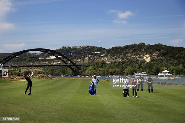 Rory McIlroy of Northern Ireland hits his second shot on the 13th hole as Chris Kirk of the United States looks on during the round of 8 in the World...