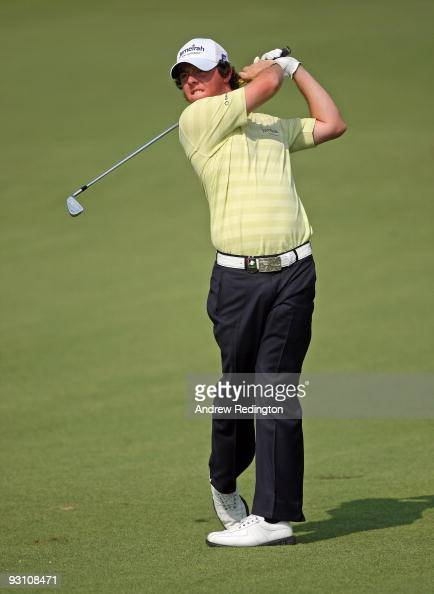 Rory McIlroy of Northern Ireland hits his second shot on the 14th hole during the Pro Am prior to the start of the Dubai World Championship on the...