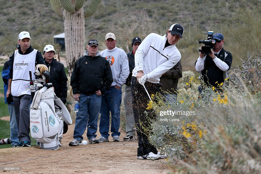 Rory McIlroy of Northern Ireland hits his second shot on the 15th hole left handed during the first round of the World Golf Championships - Accenture Match Play at the Golf Club at Dove Mountain on February 21, 2013 in Marana, Arizona. Round one play was suspended on February 20 due to inclimate weather and is scheduled to be continued today.