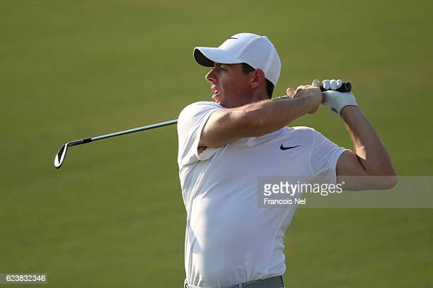 Rory McIlroy of Northern Ireland hits his second shot on the 16th hole during day one of the DP World Tour Championship at Jumeirah Golf Estates on...