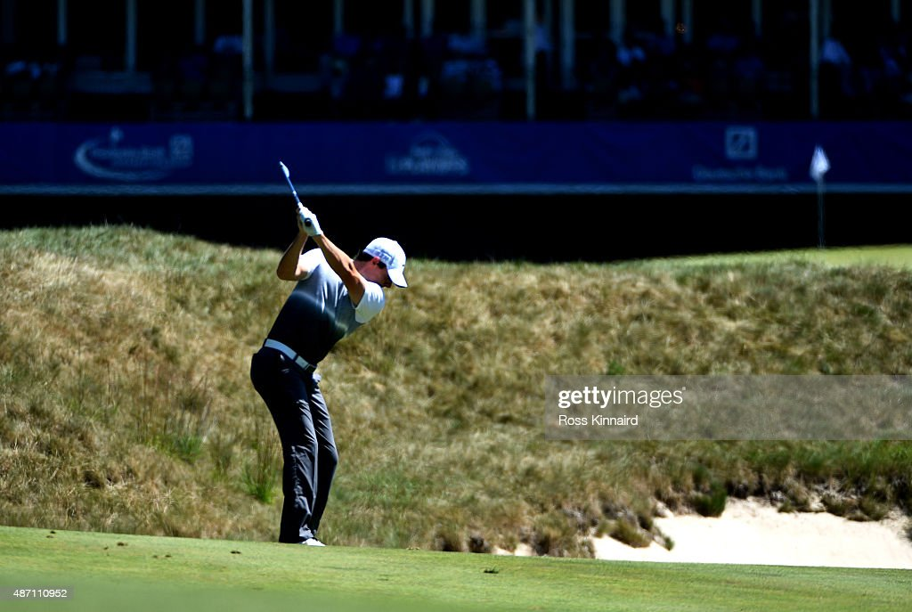 Rory McIlroy of Northern Ireland hits his second shot on the 18th hole during round three of the Deutsche Bank Championship at TPC Boston on...
