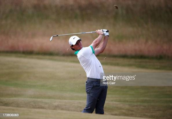 Rory McIlroy of Northern Ireland hits his second shot on the 2nd hole during the first round of the 142nd Open Championship at Muirfield on July 18...
