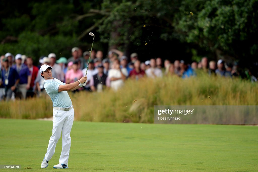 Rory McIlroy of Northern Ireland hits his second shot on the first hole during Round One of the 113th US Open at Merion Golf Club on June 13 2013 in...