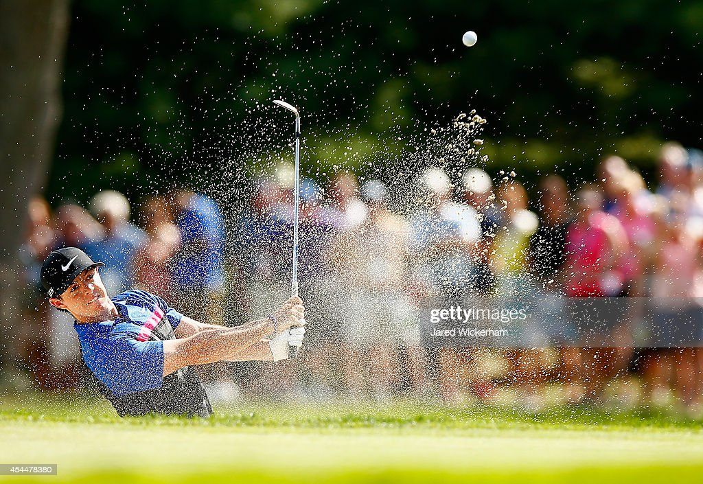 Rory McIlroy of Northern Ireland hits his shot out of the bunker on the seventh hole during the final round of the Deutsche Bank Championship at the...