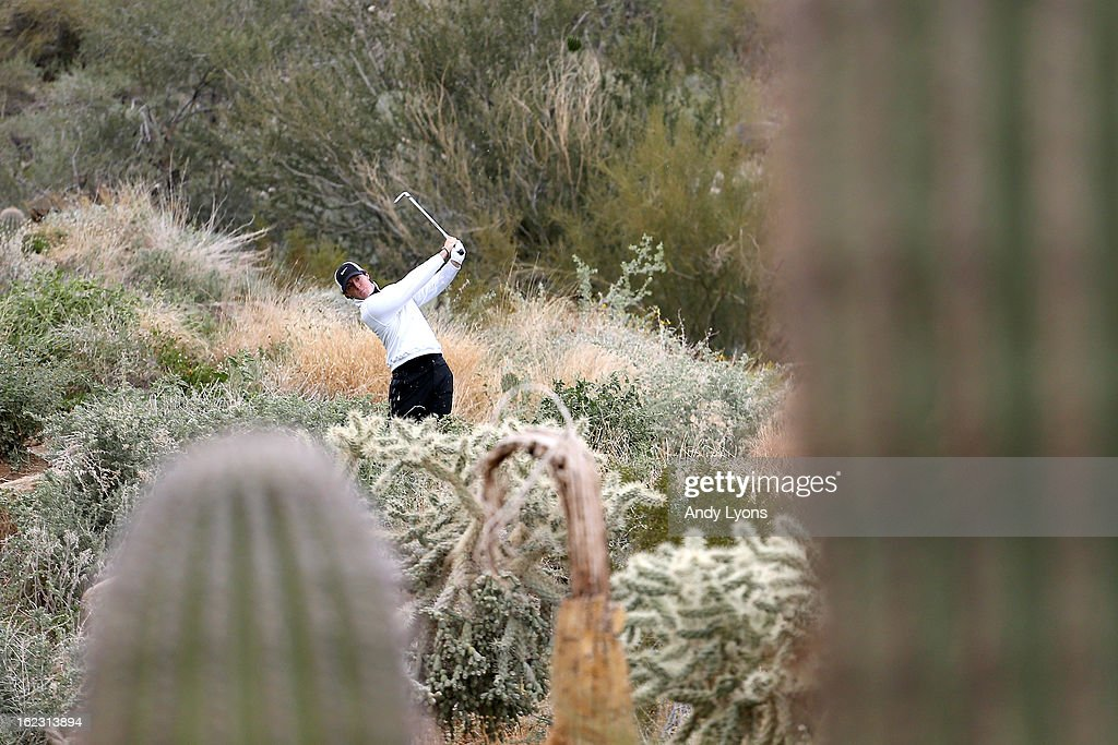 Rory McIlroy of Northern Ireland hits his tee shot on the 12th hole during the first round of the World Golf Championships - Accenture Match Play at the Golf Club at Dove Mountain on February 21, 2013 in Marana, Arizona. Round one play was suspended on February 20 due to inclimate weather and is scheduled to be continued today.