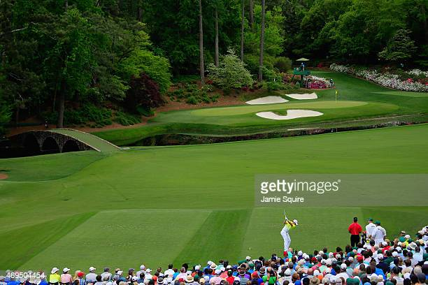 Rory McIlroy of Northern Ireland hits his tee shot on the 12th hole during the final round of the 2015 Masters Tournament at Augusta National Golf...