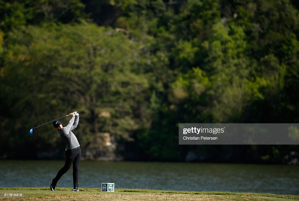 Rory McIlroy of Northern Ireland hits his tee shot on the 14th hole during the round of 16 in the World Golf ChampionshipsDell Match Play at the...