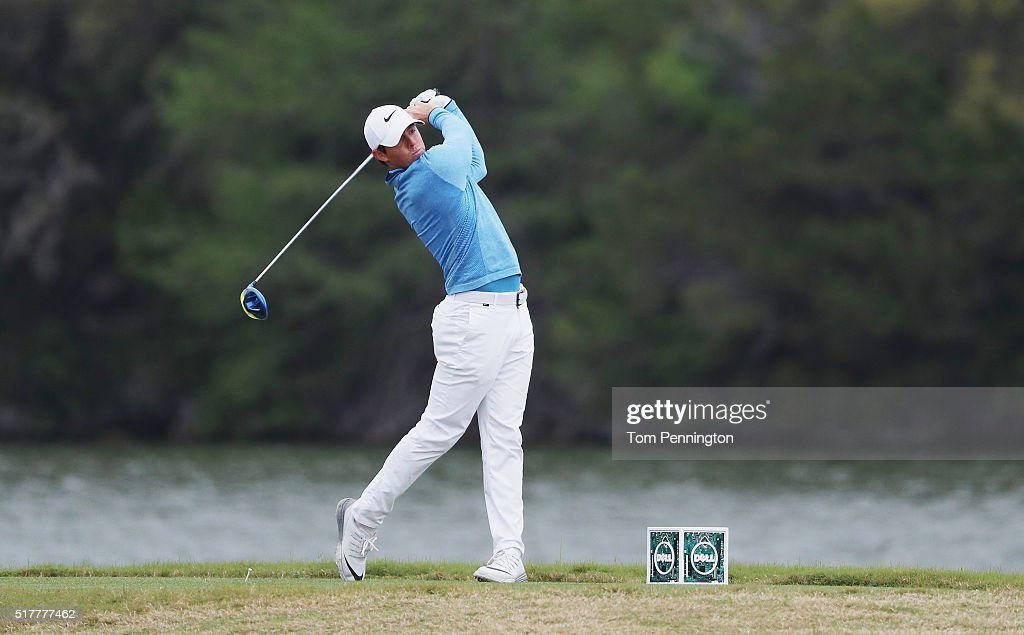 Rory McIlroy of Northern Ireland hits his tee shot on the 14th hole during his semifinal match with Jason Day at the World Golf ChampionshipsDell...