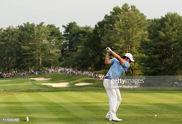 Rory McIlroy of Northern Ireland hits his tee shot on the 15th hole during the final round of the 111th US Open at Congressional Country Club on June...