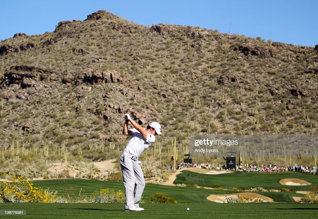 Rory McIlroy of Northern Ireland hits his tee shot on the 15th hole during the third round of the World Golf ChampionshipsAccenture Match Play...