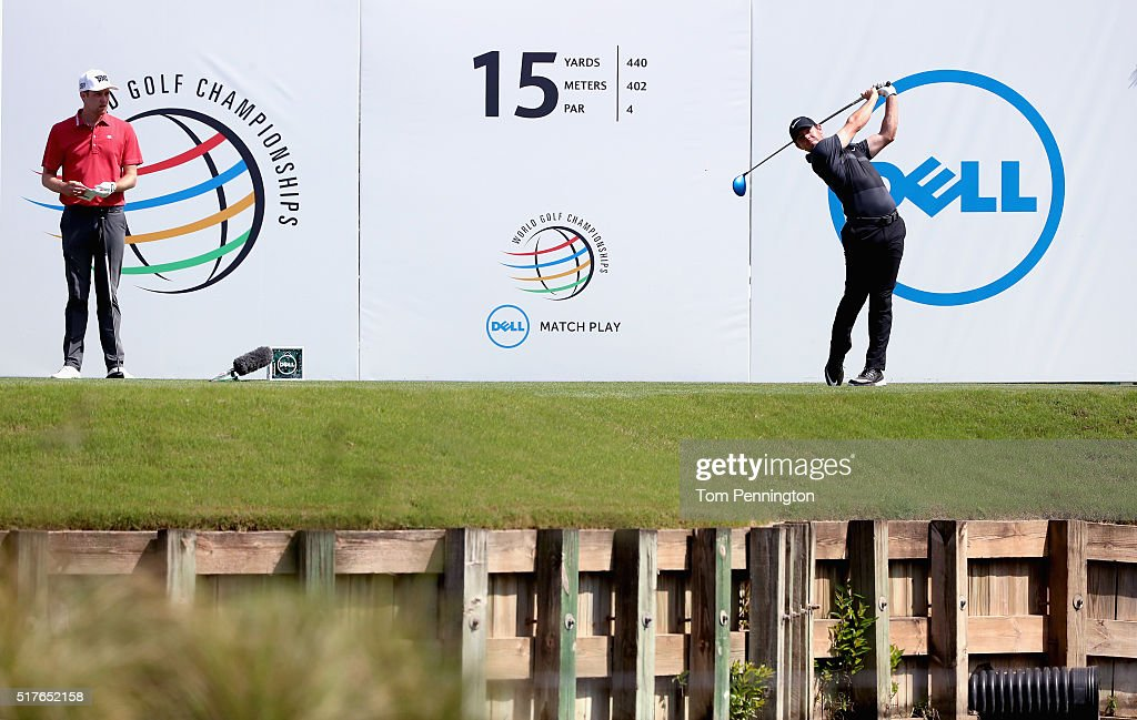 Rory McIlroy of Northern Ireland hits his tee shot on the 15th hole as Chris Kirk of the United States looks on during the round of 8 in the World...
