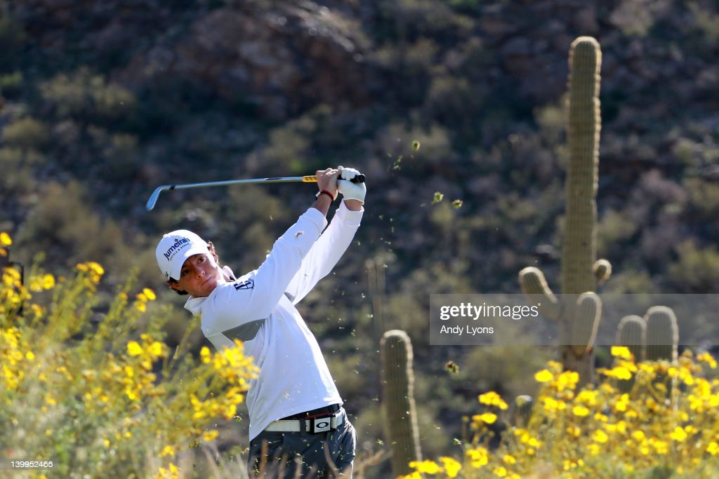 Rory McIlroy of Northern Ireland hits his tee shot on the 16th hole during the semifinal round of the World Golf ChampionshipsAccenture Match Play...