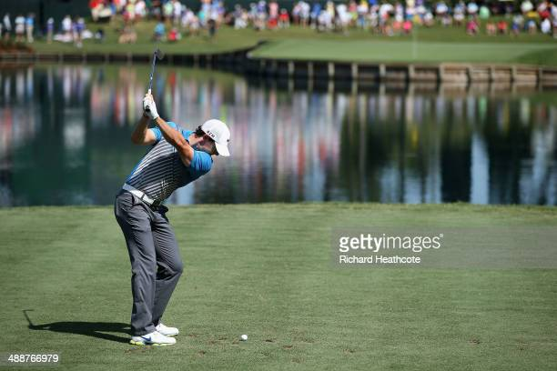 Rory McIlroy of Northern Ireland hits his tee shot on the 17th hole during the first round of THE PLAYERS Championship on The Stadium Course at TPC...