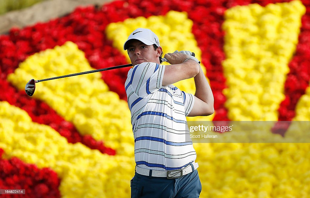 Rory McIlroy of Northern Ireland hits his tee shot on the 18th hole during the first round of the Shell Houston Open at the Redstone Golf Club on...