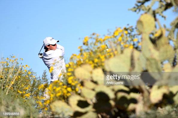 Rory McIlroy of Northern Ireland hits his tee shot on the ninth hole during the semifinal round of the World Golf ChampionshipsAccenture Match Play...