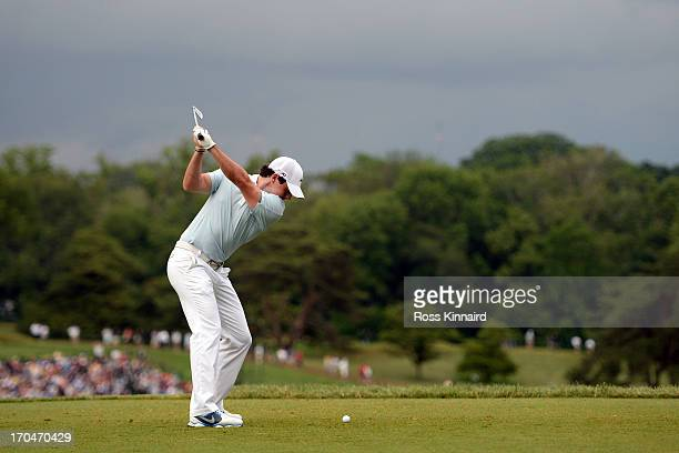 Rory McIlroy of Northern Ireland hits his tee shot on the ninth hole during Round One of the 113th US Open at Merion Golf Club on June 13 2013 in...