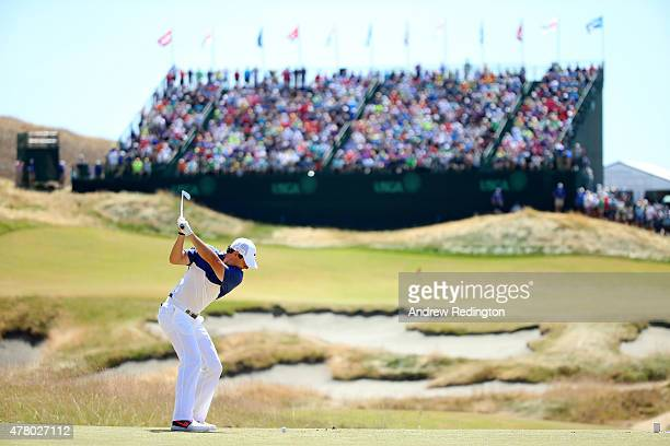 Rory McIlroy of Northern Ireland hits his tee shot on the ninth hole during the final round of the 115th US Open Championship at Chambers Bay on June...