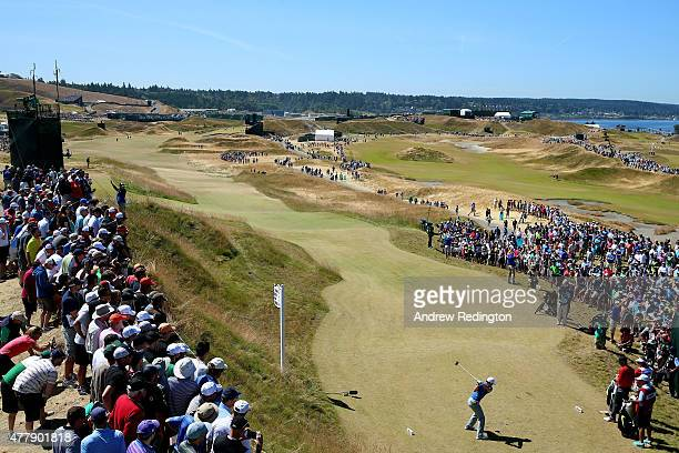 Rory McIlroy of Northern Ireland hits his tee shot on the sixth hole during the third round of the 115th US Open Championship at Chambers Bay on June...