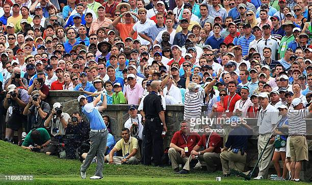 Rory McIlroy of Northern Ireland hits his tee shot on the tenth hole during the third round of the 111th US Open at Congressional Country Club on...