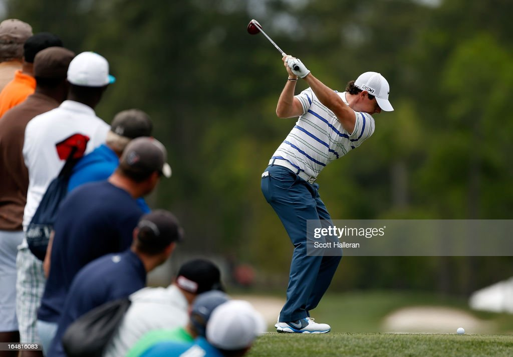 Rory McIlroy of Northern Ireland hits his tee shot on the third hole during the first round of the Shell Houston Open at the Redstone Golf Club on...