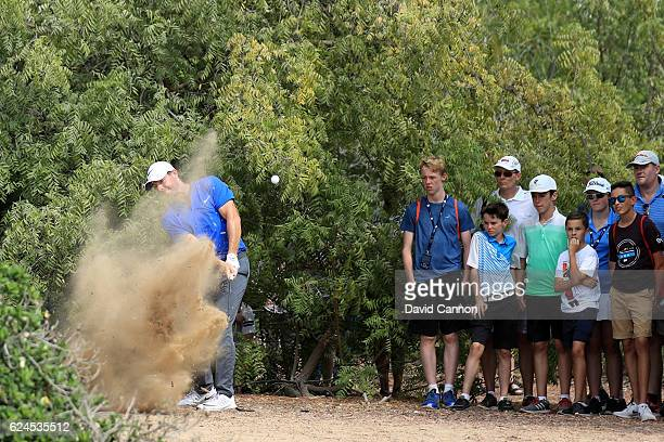 Rory McIlroy of Northern Ireland hits his third shot on the 11th hole during day four of the DP World Tour Championship at Jumeirah Golf Estates on...