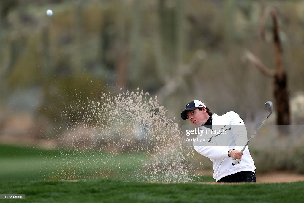 Rory McIlroy of Northern Ireland hits his third shot out of the bunker on the 15th hole during the first round of the World Golf Championships - Accenture Match Play at the Golf Club at Dove Mountain on February 21, 2013 in Marana, Arizona. Round one play was suspended on February 20 due to inclimate weather and is scheduled to be continued today.
