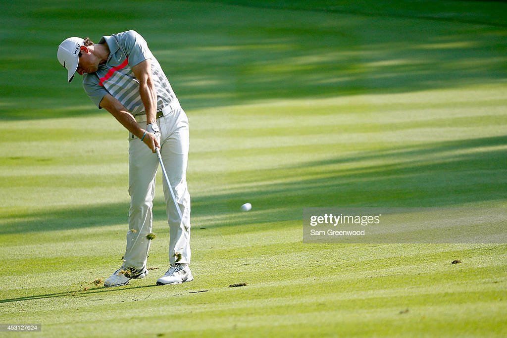 Rory McIlroy of Northern Ireland hits off the 13th fairway during the final round of the World Golf Championships-Bridgestone Invitational at Firestone Country Club South Course on August 3, 2014 in Akron, Ohio.