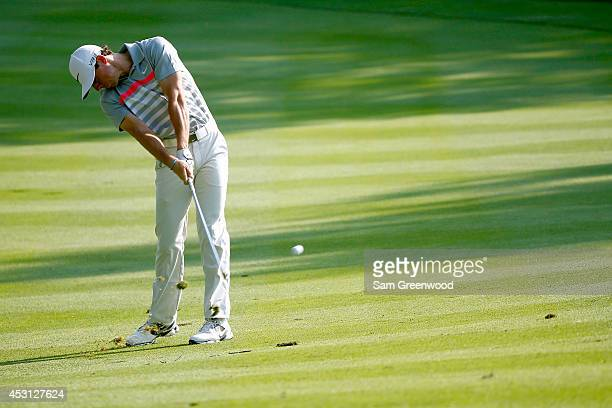 Rory McIlroy of Northern Ireland hits off the 13th fairway during the final round of the World Golf ChampionshipsBridgestone Invitational at...