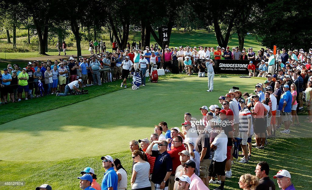 Rory McIlroy of Northern Ireland hits off the 14th tee during the final round of the World Golf Championships-Bridgestone Invitational at Firestone Country Club South Course on August 3, 2014 in Akron, Ohio.