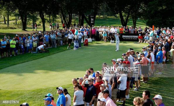 Rory McIlroy of Northern Ireland hits off the 14th tee during the final round of the World Golf ChampionshipsBridgestone Invitational at Firestone...