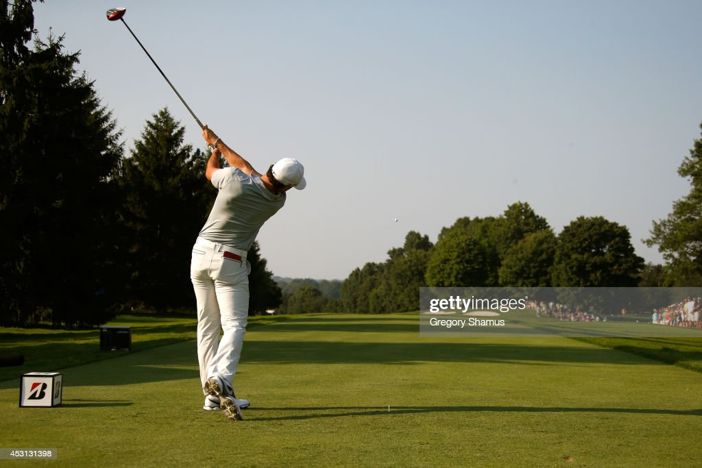 Rory McIlroy of Northern Ireland hits off the 16th tee during the final round of the World Golf Championships-Bridgestone Invitational at Firestone Country Club South Course on August 3, 2014 in Akron, Ohio.