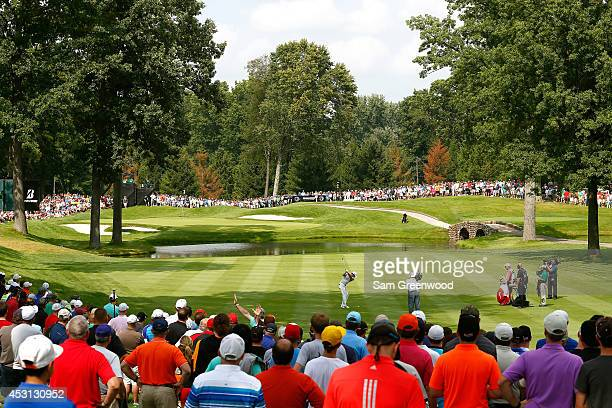 Rory McIlroy of Northern Ireland hits off the third tee during the final round of the World Golf ChampionshipsBridgestone Invitational at Firestone...