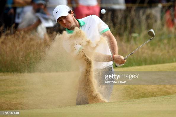 Rory McIlroy of Northern Ireland hits out of a bunker on the 1st hole during the first round of the 142nd Open Championship at Muirfield on July 18...