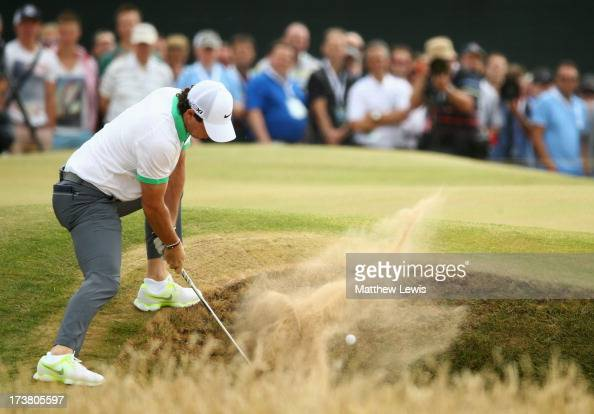 Rory McIlroy of Northern Ireland hits out of a bunker on the 5th hole during the first round of the 142nd Open Championship at Muirfield on July 18...