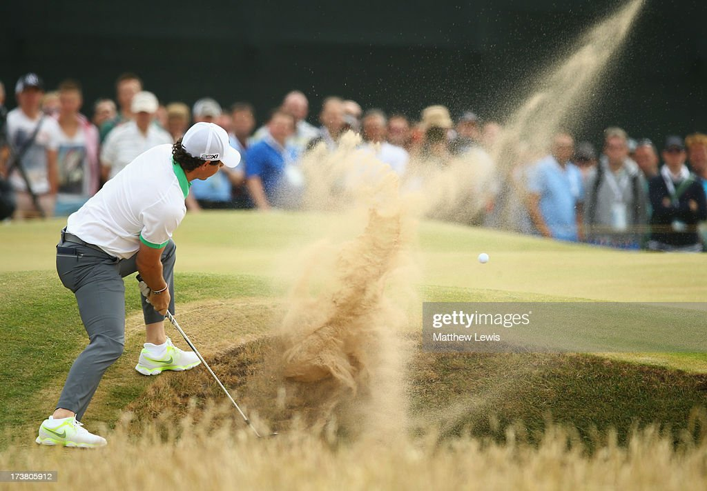 Rory McIlroy of Northern Ireland hits out of a bunker on the 5th hole during the first round of the 142nd Open Championship at Muirfield on July 18, 2013 in Gullane, Scotland.