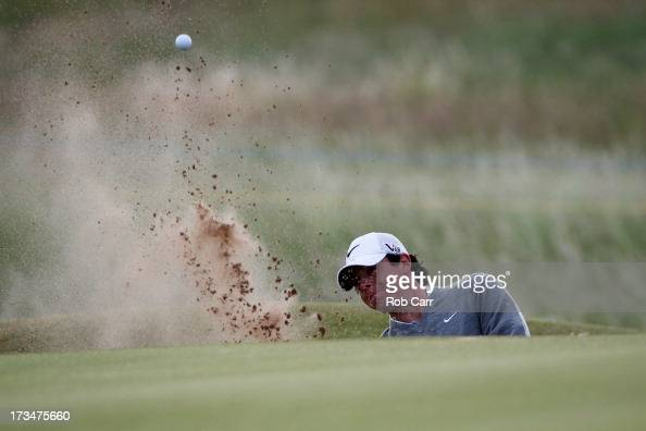 Rory McIlroy of Northern Ireland hits out of the bunker on the 12th hole ahead of the 142nd Open Championship at Muirfield on July 15 2013 in Gullane...