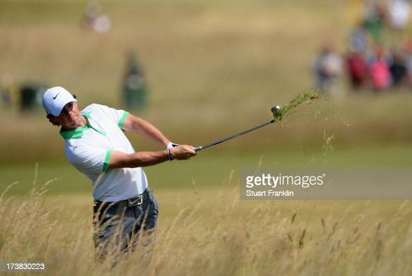 Rory McIlroy of Northern Ireland hits out of the rough on the 14th hole during the first round of the 142nd Open Championship at Muirfield on July 18...