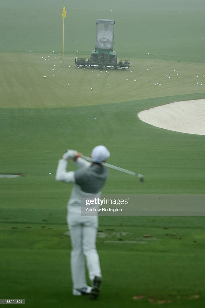 Rory McIlroy of Northern Ireland hits shots on the practice range during a practice round prior to the start of the 2014 Masters Tournament at Augusta National Golf Club on April 7, 2014 in Augusta, Georgia.