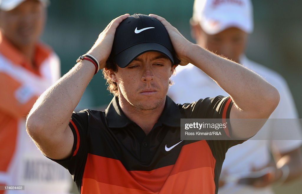 <a gi-track='captionPersonalityLinkClicked' href=/galleries/search?phrase=Rory+McIlroy&family=editorial&specificpeople=783109 ng-click='$event.stopPropagation()'>Rory McIlroy</a> of Northern Ireland holds his head walking off the 18th green during the second round of the 142nd Open Championship at Muirfield on July 19, 2013 in Gullane, Scotland.