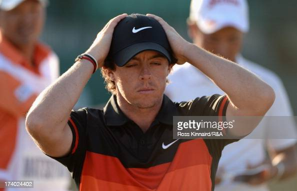 Rory McIlroy of Northern Ireland holds his head walking off the 18th green during the second round of the 142nd Open Championship at Muirfield on...