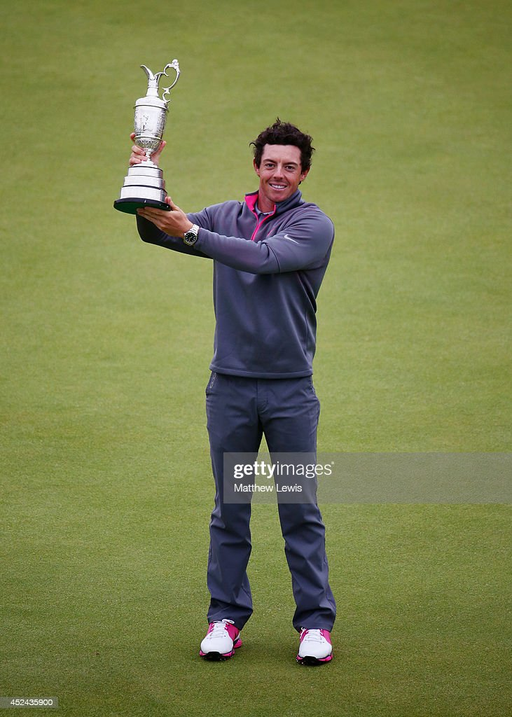 <a gi-track='captionPersonalityLinkClicked' href=/galleries/search?phrase=Rory+McIlroy&family=editorial&specificpeople=783109 ng-click='$event.stopPropagation()'>Rory McIlroy</a> of Northern Ireland holds the Claret Jug aloft after his two-stroke victory at The 143rd Open Championship at Royal Liverpool on July 20, 2014 in Hoylake, England.
