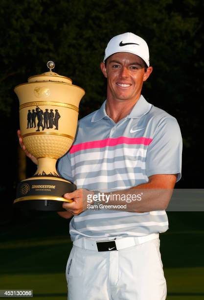 Rory McIlroy of Northern Ireland holds the Gary Player Cup trophy after winning the World Golf ChampionshipsBridgestone Invitational with a score of...