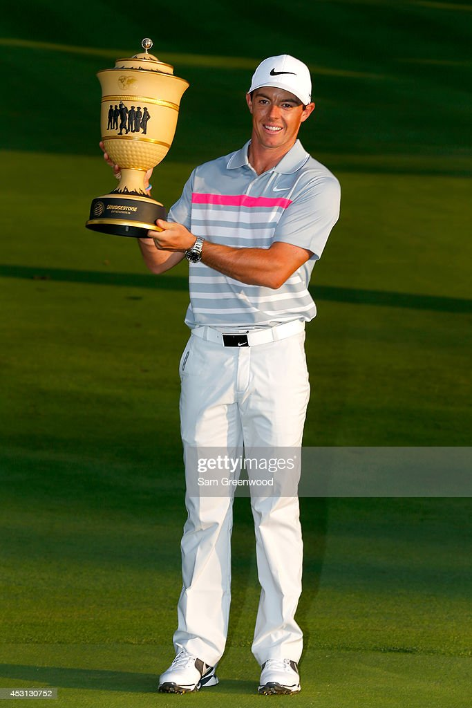 Rory McIlroy of Northern Ireland holds the Gary Player Cup trophy after winning the World Golf Championships-Bridgestone Invitational with a score of -15 during the final round at Firestone Country Club South Course on August 3, 2014 in Akron, Ohio.