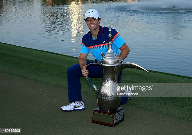 Rory McIlroy of Northern Ireland holds the trophy at the presentation after the final round of the 2015 Omega Dubai Desert Classic on the Majlis...