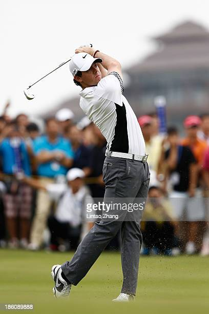 Rory McIlroy of Northern Ireland in action during his match against Tiger Woods of the United States at Blackstone Course Mission Hills on October 28...